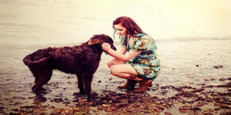 woman and dog by lake