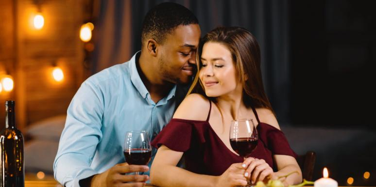 interracial couple snuggles during a romantic date