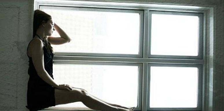 woman sad by window