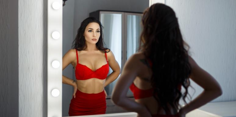 woman in lingerie looking into mirror