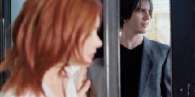 redhead shutting door on man