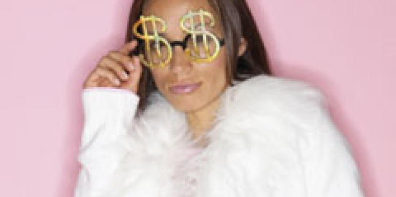 woman with dollar sign sunglasses