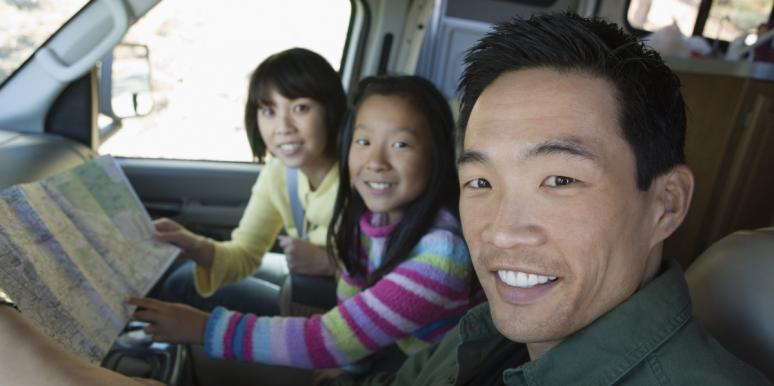 Family looking at map in RV