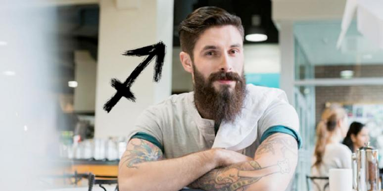 bearded man with sagittarius symbol