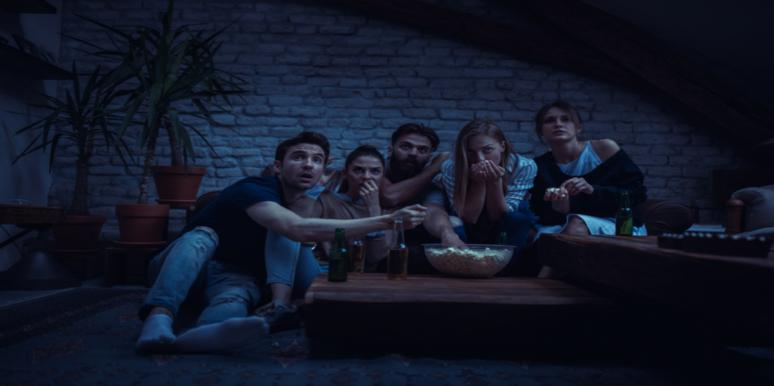 Group of friends watching the scariest movies