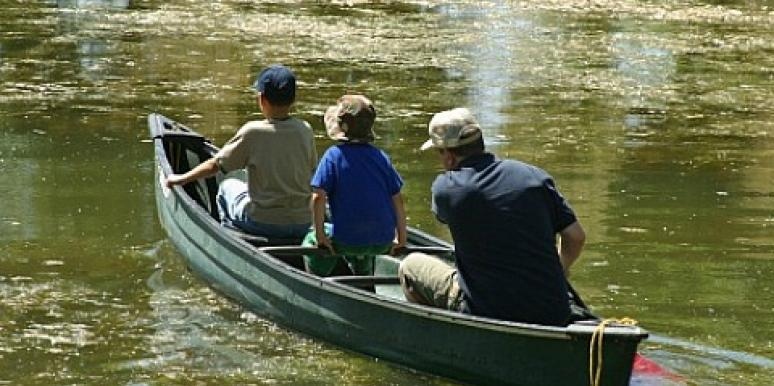 father and sons rowing boat