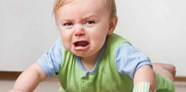blonde baby screaming and crying