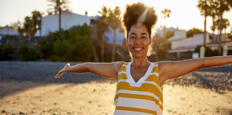 woman happy on the beach