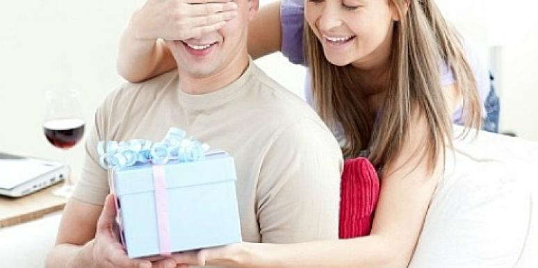woman giving husband birthday present