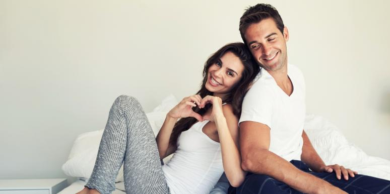 couple wearing white in bed