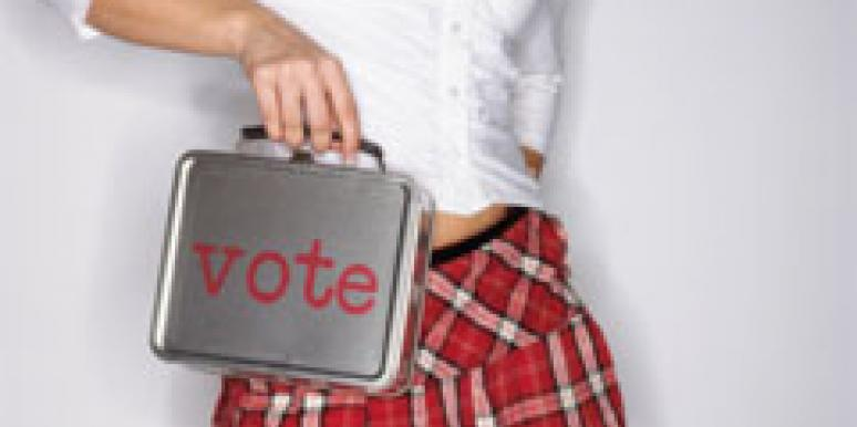 woman with short skirt holding bag that says vote