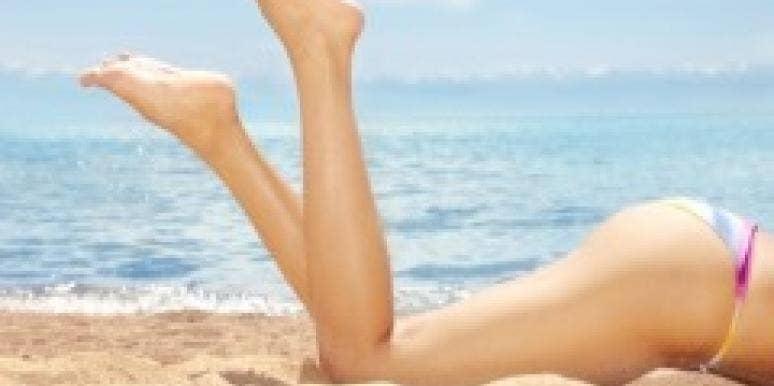Sexy summer legs beach