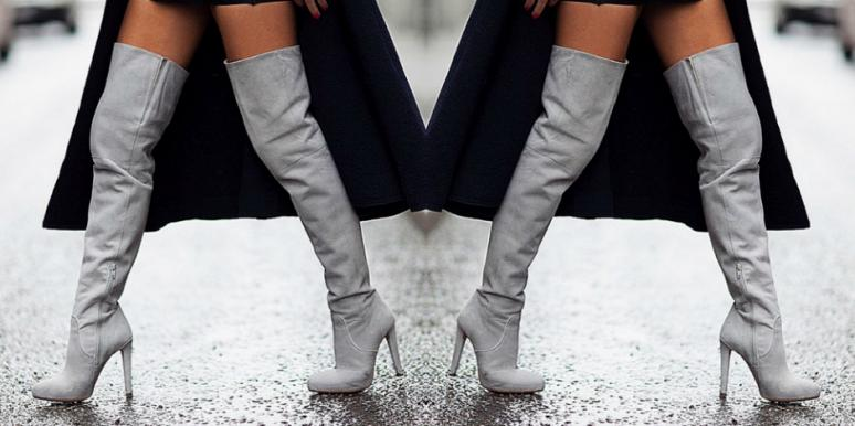 woman wearing knee-high boots