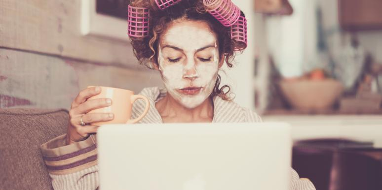 woman working at home in curlers