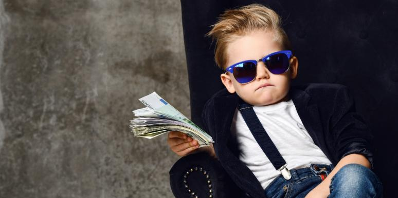 kid showing off his stack of cash