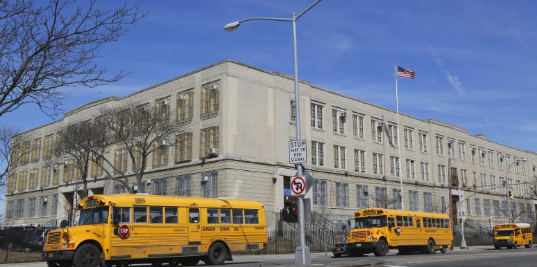 school buses in front of school