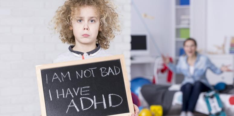 kid holding adhd sign