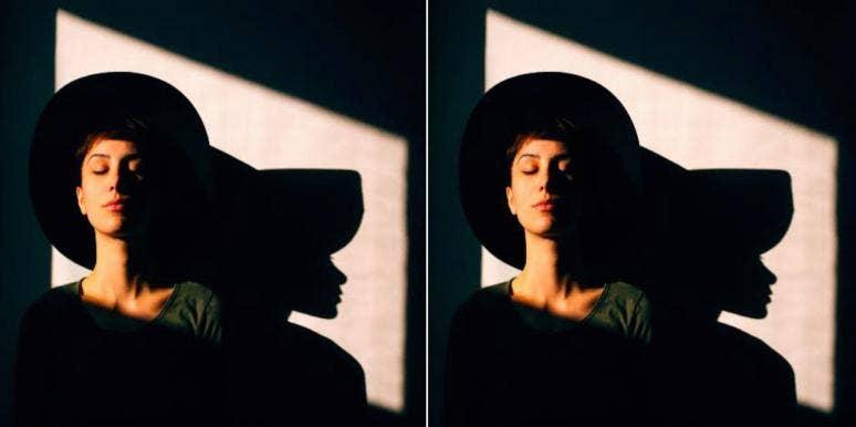 woman in hat sitting in the dark