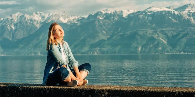 woman sitting in front of mountains