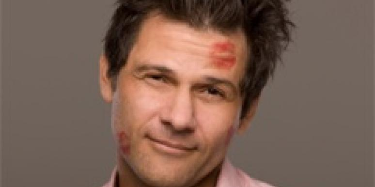man with lipstick kiss on face