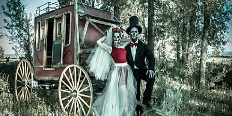 skeletons wedding photo in front of carriage