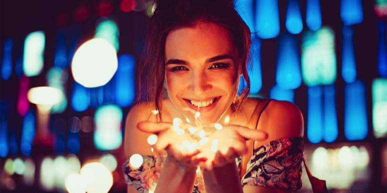 woman holding lights