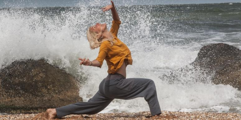 woman dancing with the waves
