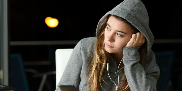 sad woman listening to songs for the dumped