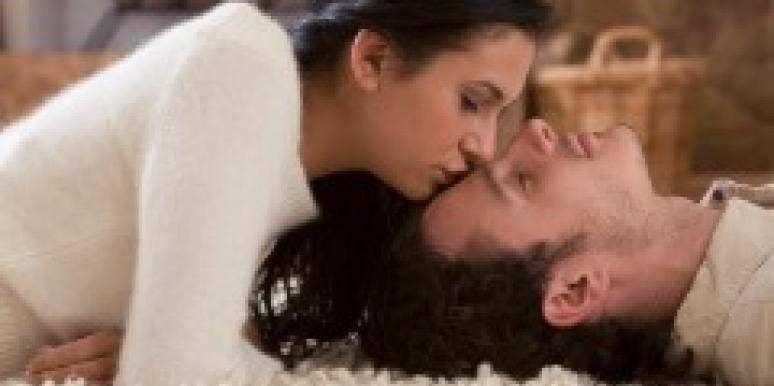 woman kissing man's forehead