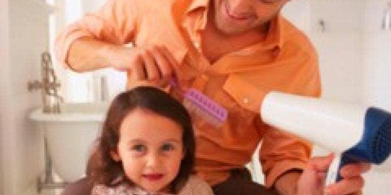 dad blow drying daughter's hair