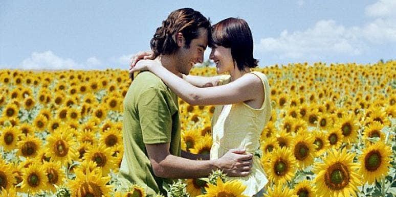 couple in sunflower field.