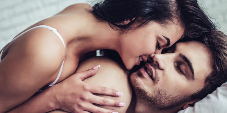 woman saying dirty things to a man in bed