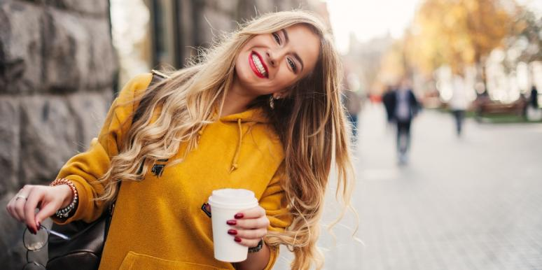 happy woman holding glasses and coffee cup