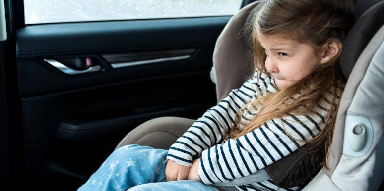 toddler girl in carseat