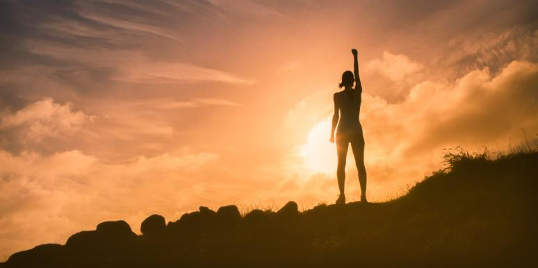 woman on top of mountain