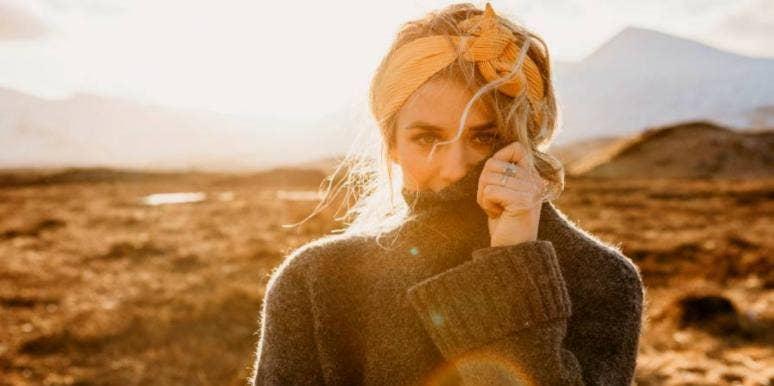 sad woman in sweater