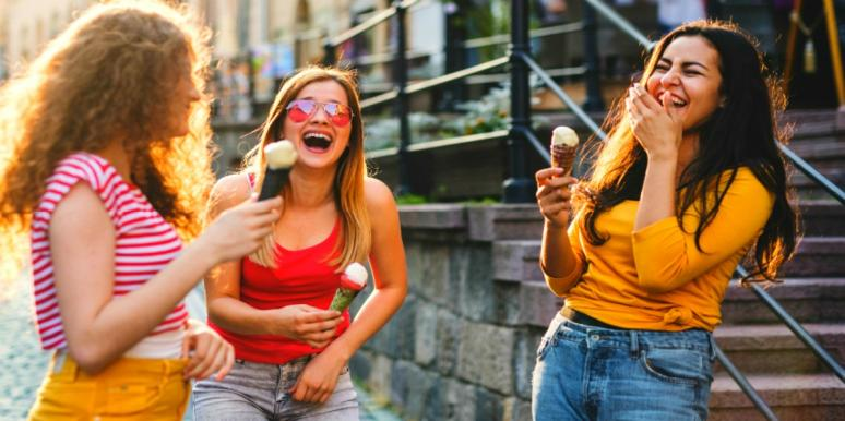 friends laughing eating ice cream