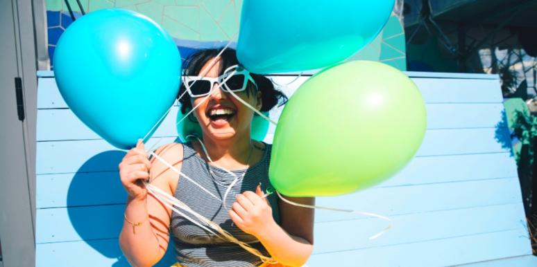 woman with balloons considering relationship red flags
