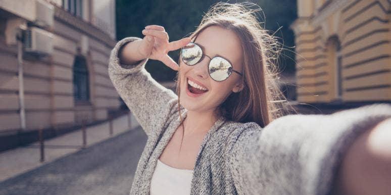 happy woman taking a selfie