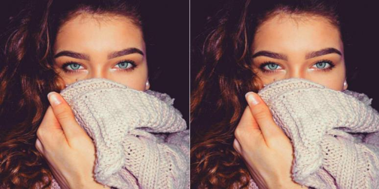 woman with sweater over her mouth