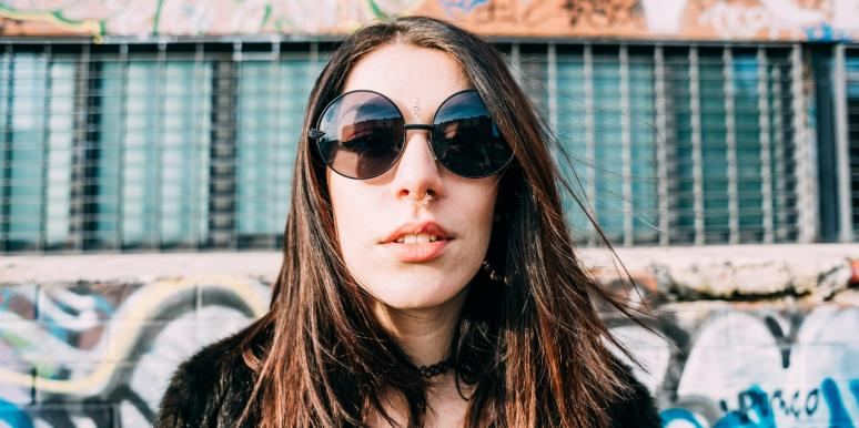 woman with septum piercing wearing sunglasses