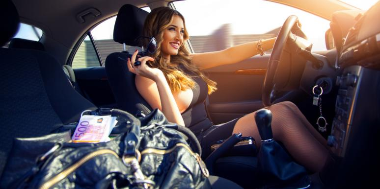 fancy rich woman driving a car