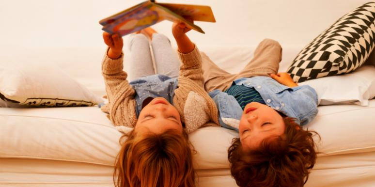 children reading on a bed