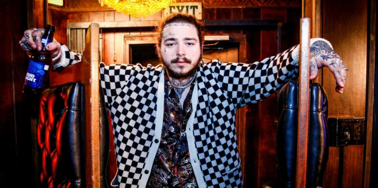 Post Malone standing with beer