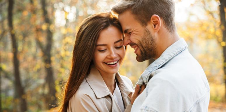 happy couple embracing smiling