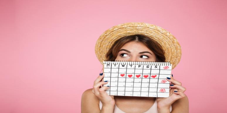 woman holding period schedule