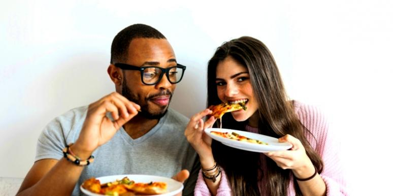 couple eating free pizza