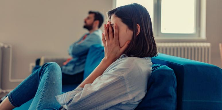 heartbroken woman on couch with man