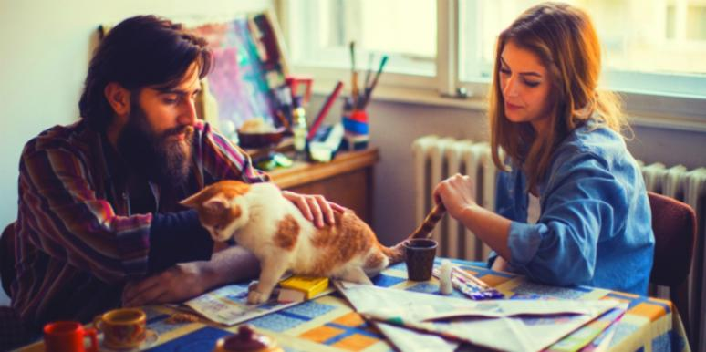 husband and wife with cat