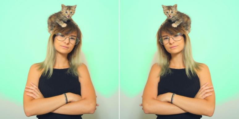 woman with kitten on her head